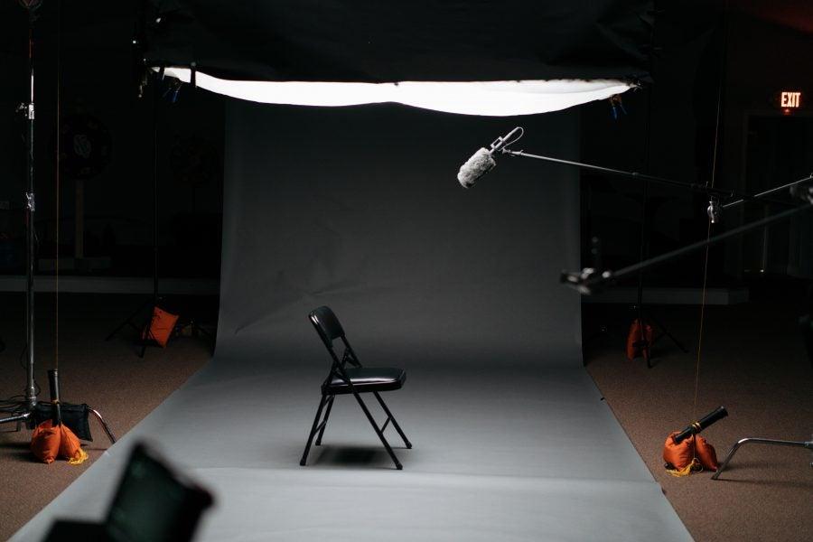 black folding chair on canvas